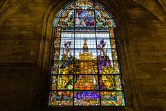 Stained-glass window in Seville cathedral (andbog) Tags: sony alpha ilce a6000 sonya6000 emount mirrorless csc sonya oss sel 1650mm selp1650 spagna spain espaa es sony sonyalpha sony6000 sonyilce6000 sonyalpha6000 6000 ilce6000 andalusia andalucia sevilla siviglia seville architettura architecture building edificio church chiesa iglesia catedral cathedral cattedrale indoor interior handheld gothic espana inner window finestra stainedglass giralda
