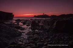 Lighthouse (The Original Happy Snapper) Tags: sunset sea sky lighthouse seascape seaweed beach nature water clouds landscape seaside still rocks outdoor peaceful boulders pebble seashore