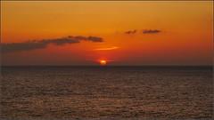 Sunset from Cape Manzamo (rolo_061) Tags: travel sunset sea sky orange cliff beach water japan skyline night clouds island lumix evening coast outdoor dusk horizon peaceful okinawa rolo endless nepali islandlife goodday redsun traveldiaries capemanzamo gf5 capemanza rohite