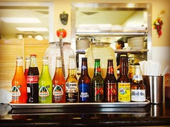 (wirednerd) Tags: soda beer bottles row mexican restaurant drinks modelo budlight coronaextra dosequis jarritos cocacola cerveza pacifico labels tray