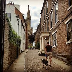 Durham (orlaithnimhurchu) Tags: durham streetphotography street dogwalker dog cobbles cobbledstreet redbrickhouse redbrick durhamcathedral cathedral view