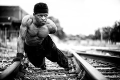 Martel VII (giladvalkor) Tags: man people guy gritty blackandwhite cap black fitness muscles exercise railroadtracks pushups shirtless abs physique body