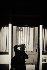 The Days Have Come and Gone (Thomas Hawk) Tags: america americanflag california mission missiondistrict sanfrancisco usa unitedstates unitedstatesofamerica flag selfportrait shadow
