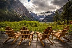 Please, take a seat (Mala Gosia) Tags: kajtek malagosia oct102016 lakelouise banffnationalpark ab outdoor chairs muskokachairs fence bush canoneos6d landscape canada water lake trees stones rocks rockies alberta fairmontchateau