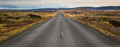 The Road Ahead (www.theaperturegeek.com) Tags: iceland icelandic road horizon outdoors travel travelphotography canon 70d sigma 1770 north northern hemisphere mountain mountains peakes snow cold sky landscape barren alone calm serene tranquil quiet lava field nopeople adventure island highway freeway distance view vista
