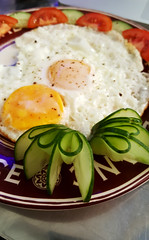 Decorated eggs (Roving I) Tags: friedeggs breakfasts decoration cucumber dining cafes cabanon danang vietnam vertical tomatoes