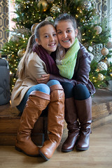 Sisterly Hug (Monkey Mash Button) Tags: christmas portrait tree girl sisters pen lens four lumix lights pretty braces boots picture smiles pic olympus teen micro 17 20mm scarves nieces thirds m43 mft panansonic mirrorless epm2