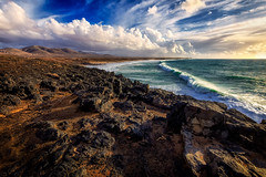 A Walk On The West Side (simon james_f) Tags: sky colour texture clouds coast fuerteventura vivid scape volcanic canaryislands rockformations elcotillo singleraw simonjamesfoot