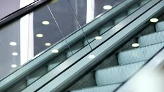 Up and down escalators (greycoastmedia) Tags: motion up modern mall way video stair lift escalator transport shoppingcentre indoor down upstairs step automatic downstairs tradecentre footage movingstaircase movingstairway stockvideo greycoastmedia