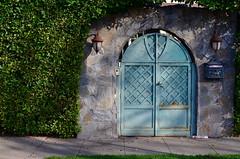 Arcana (MPnormaleye) Tags: door wood city urban lamp stone wall yard garden wooden village entrance neighborhood hedge utata portal lantern shrub
