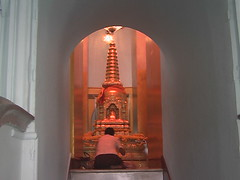 Praying to Buddha in a Thai Temple