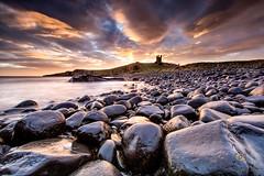 Dunstanburgh Castle Sunrise (Sh0ckw4ve) Tags: longexposure morning pink blue sea seascape castle clouds sunrise coast rocks northumberland lee dunstanburgh leefilters