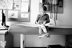 January 9 : Another Day Another Doctor (RachelBrandtPhotography) Tags: blackandwhite bw girl reading book office kid waiting child sandiego daughter read doctor wait littlegirl sick doctorsoffice patience sandiegochildphotographer sandiegochildphotography sandiegofamilyphotography sandiegofamilyphotographer rachelbrandt rachelbrandtphotography