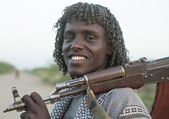 Afar Tribe Warrior, Afambo, Afar Regional State, Ethiopia (Eric Lafforgue) Tags: africa portrait people haircut men smile smiling horizontal closeup hair outdoors photography gun day adult african culture tribal weapon warrior tradition ethiopia tribe ethnic hairstyle curlyhair cultures anthropology oneperson hornofafrica ethnology ethiopian afar eastafrica humanhair kalashnikov realpeople 2025years humanface colorimage lookingatcamera onlymen colorpicture onemanonly onematuremanonly danakil africanethnicity pastoralists 1people indigenousculture africanculture nomadicpeople colourpicture afambo assaita asaita assayta sharpenedteeth ethio1408639