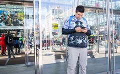 Wired Alien (UrbanphotoZ) Tags: nyc newyorkcity ny newyork man reflections manhattan alien tshirt midtown smartphone reception backpack westside darthvader comiccon focused javitscenter videogamehighschool