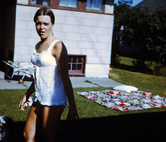 1960s sunbathing in yard (sundogrr) Tags: summer house girl grass yard blanket suntan 1960s swimsuit tanning teenage