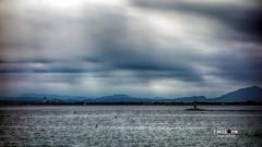 Cloudy waterfront. (Jean McLane) Tags: seascape blue waterfront water hdr sea cloudy clouds nuages nubes