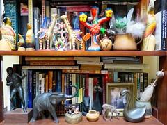 two shelves (Black Cat Bazaar) Tags: elephant birds animals vintage blackcat ceramic folkart personal collection giraffes trophy myworld boxing carvedwood knickknacks collector treeoflife everythingelse lotsofbooks twoofmany hardtodust