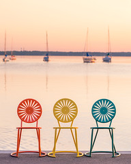 Union Chairs (ryanmense) Tags: color water wisconsin sailboat sunrise madison uwmadison sunburst madisonwi memorialunion unionterrace wisconsincapitol madisonart wisconsinart wisconsinphotographer wisconsinphotography madisonphotographer madisonphotography wisconsinsunrise ryanmense