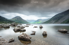 Rocky calm. (DigitalAutomotive) Tags: the lake district july 2016 buttermere cumbria crummock water stormy day wet weather clouds green trees tree line fence vista view lakes england english tourism visit visiting outdoor cloud sky hill landscape mountainside sunset fire evening visitcumbria watercourse