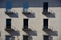 Descriptive geometry (jacques_teller) Tags: spain madrid nikon d7200 window facade shadow balconies shutter abstract geometry sun projection regular beige espaa espagne frame flickr building flat frontal architecture outside