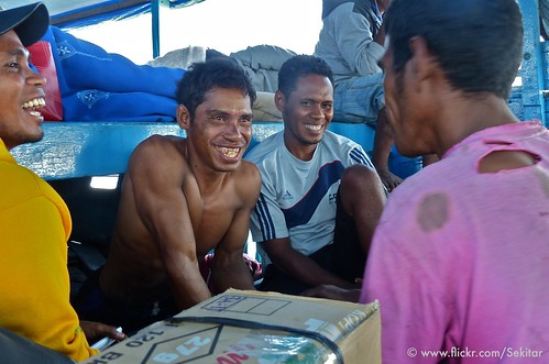 Machinist and passengers, boat from Pantar to Alor NTT Indonesia