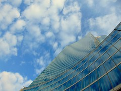Always feeling as big as an ant. (lettodimosche) Tags: blue italy milan reflection art glass modern italia modernart milano bluesky piece modernarchitecture sunnyday pieceofart palazzolombardia