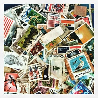 001/365 • DB was tasked with pulling all the stamps out of my ancient stamp album - she's only a third of the way through. I'm guessing they'll be good for craft projects... • #001_2015 #dayone #stamps #manystamps