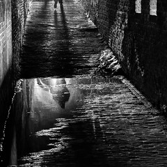 Day 335 (Wouter de Bruijn) Tags: light blackandwhite reflection water monochrome dark walking puddle shadows tunnel fujifilm 365 veere 335 xt1 fujinonxf35mmf14r