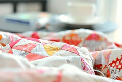 Saturday Afternoon (balu51) Tags: red white black cup window backlight triangles table afternoon quilt bokeh sewing wip patchwork cupoftea februar hourglass basting f35 2015 quilttop hourglassquilt copyrightbybalu51