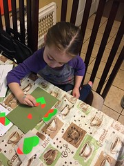 Isabella working on the card