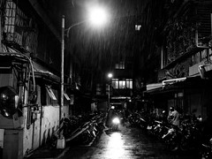 motorcyclist in the rainy night (xnayc) Tags: street city light people urban blackandwhite rain night snapshot taiwan motorcycle gr ricoh newtaipeicity