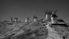 The giants of Don Quixote (Carlos Gotay Martnez) Tags: sky landscape nature light outdoor outside road texture blackandwhite grass history hills dry drought arid terrain dryland travel spain windmills consuegra fineart donquijote castilla traveldestination donquixote lamancha bw