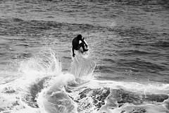 Lift Off!!! (Wildlife_Biologist) Tags: ocean sea blackandwhite bw beach monochrome outdoors person coast sand surf air wave spray liftoff human shore southerncalifornia soaring airborne skimboarding humanbeing lagunabeach skimboard homosapiens skimboarder catchingair wildlifebiologist jeffahrens