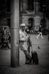 The traveller (erikvdlinden) Tags: blackandwhite bw man male hat bag streetphotography luggage suitcase candidshot travelbag