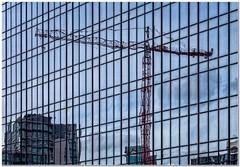 The red crane (Hugh Stanton) Tags: window mirror reflection crane city tower appickoftheweek