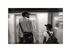 Father & Son - Subway, Manhattan (Nico Geerlings) Tags: ngimages nicogeerlings nicogeerlingsphotography manhattan ny nyc us usa newyorkcity leicammonochrom 35mm summicron subway platform commuters