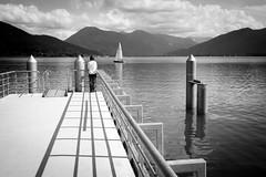 waiting for the boat (Alexander.Hls) Tags: water lake summer boat mountains bavaria blackwhite shadows blackandwhite