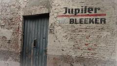 Way past beer o'clock! (babs van beieren) Tags: beer olddoor door bruges 7dwf crazytuesday textures advertising jupiler decay bladderingpaint