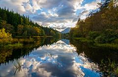 Glencoe Lochan (jilliannelson17) Tags: glencoe lochan sun clouds trees scotland reflections