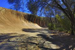 Wave Rock at Hyden, Western Australia (Clement Tang ** busy **) Tags: travel summer nature landscape shadows bluesky shades westernaustralia hdr waverock rockformation weathering treeshadows hyden closetonature concordians