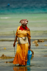 Fishing for squid @ Zanzibar (PaulHoo) Tags: africa travel blue sea orange woman color fashion lady d50 tanzania coast fishing nikon dress vibrant adventure squid zanzibar 2008 lightroom