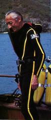 Cousteau standing his yellow striped wetsuit. (Vintage Scuba) Tags: red man black men wet yellow fetish silver james us divers pants mask boots tail stripe gear scuba diving double hose beaver equipment suit jacket bond hood diver beavertail fin jacques booties striped fins wetsuit 007 regulator cousteau