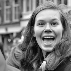 Hey! (d_t_vos) Tags: street winter portrait blackandwhite bw woman white black haarlem girl face mouth outside eyes bright candid coat teeth hey snapshot streetphotography facades wintercoat surprise teenager surprised cheerful yelling yell youngwoman grotemarkt facesofportraits dickvos dtvos