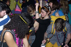 Endymion Dance Party (tomtomklub) Tags: street city carnival people urban black men beer smiling yellow night laughing dark beads women louisiana dress diverse dancing weekend neworleans flash crowd group young parade drinks backpack stick shorts mardigras mid glo 20s endymion