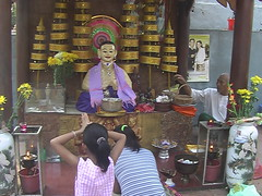Giving Offerings at Wat Phnom Cambodia