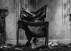 Gedney Railway Station Closed Since 1959 (BenChapmanphoto) Tags: blackandwhite bw monochrome wall mono march chair fuji decay seat lincolnshire burnt fujifilm derelict charred urbex gedney 2015 legacylens canonfd50mm18sc fujifilmxpro1