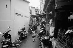 Boy (Purple Field) Tags: contax tvs carl zeiss variosonnar 28mmf3556mmf65 fuji neopan iso400 presto bw monochrome film analog 35mm jakarta indonesia street alley walking                  bike