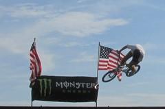 Bike in flight (Rose*Bud) Tags: bike stunt air flights flag usa summer beach boardwalk nj