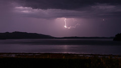 Lightning over Loch Ewe (Tel_G) Tags: lightning lochewe loch ewe night longexposure long exposure water sky cloud rain beach hills gairloch scottish scottishhighlands highlands westerross wester ross lake rocks sand canon eos 50d landscape sigma 18250 poolewe inverewe